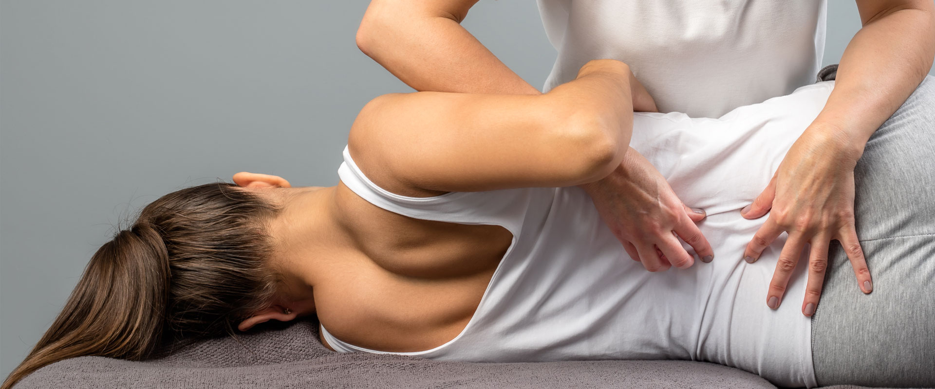 Woman receiving low back pain treatment in Edmonton